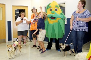James Miller/The Marion Star Leo Curry reacts after his dog Basha won the Poppin' Pooch Pagent contest held at the Yancey Clinic on Saturday, July 21, 2012.