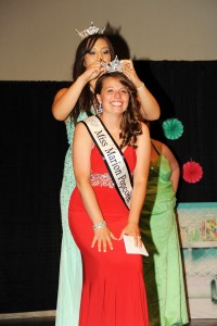 Kari Boles crouches down to be crowned 2014 Miss Marion Popcorn Festival queen at River Valley High School, Saturday, Aug. 2, 2014. For The Marion Star/Melanie Straka