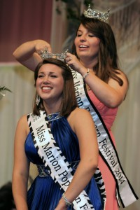 Miss Marion Popcorn Festival 2015, Elizabeth Corwin is crowned by Kari Boles, Miss Marion Popcorn Festival 2014 in festivities at River Valley High School on Saturday night.